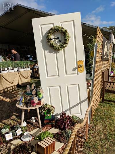 Alice's talking door, with succulent wreath clock