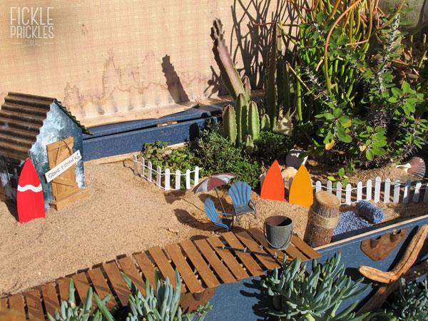 Succulent miniature beach in a large blue chest